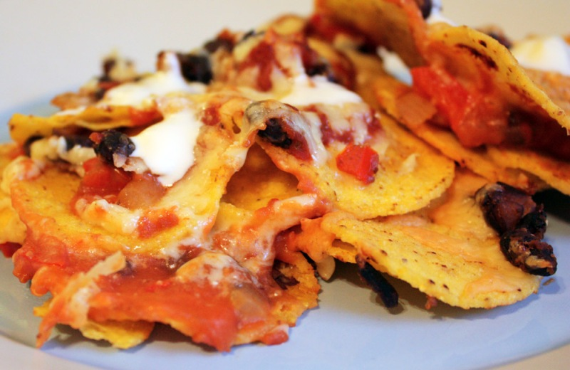 Nachos with black beans, salsa and sour cream